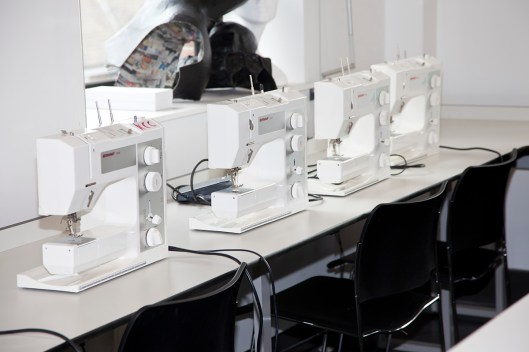 Photo: Fashion designers sowing machines, photography by London Fashion Photographer Margaret Yescombe