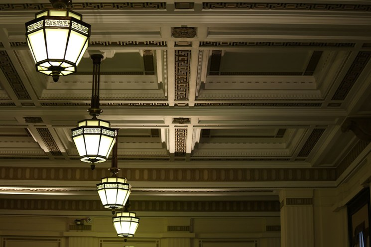 Ornate ceiling and lamp shades above Fashion Scout Exhibition. Margaret Yescombe Photography London