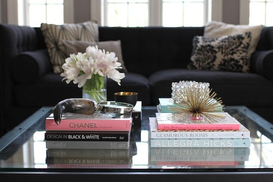 Pink in the Living Room Coffee Table with Books and Black Couch with Throw Pillows White Flowers