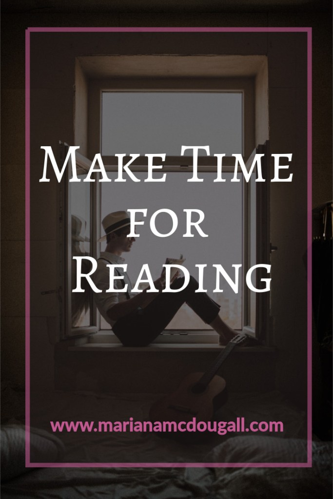 Make time for reading, www.marianamcdougall.com, man wearing a hat sitting on a windowsill and reading, Photo by Kinga Cichewicz on Unsplash