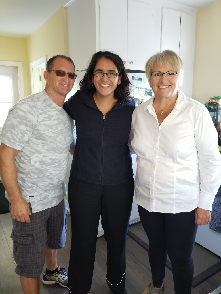 Making new friends in Herring Cove: Walter Conrad, Mariana Abeid-McDougall, and Kathy Conrad standing in the Conra'ds kitchen.