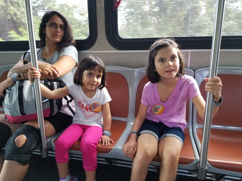 Mother and two daughters riding the bus from Fort Wilderness to Magic Kingdom