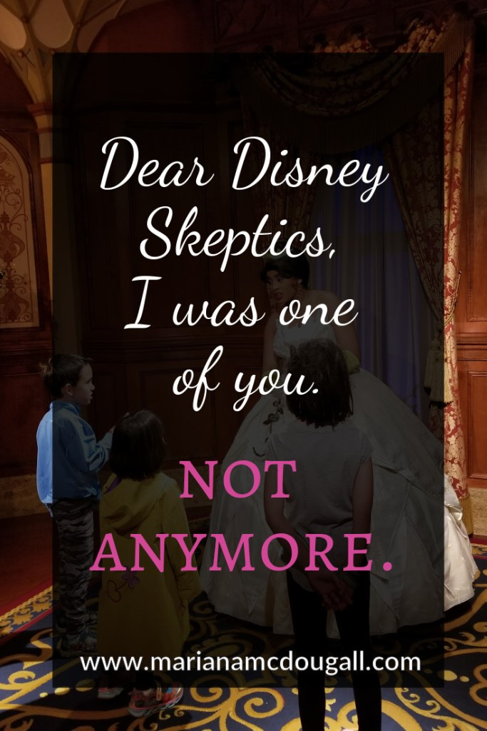 "Blog Title Pinterest Image in white and pink letters on a faint black background. The words say: ""Dear Disney Skeptics, I was one of you. Not anymore. www.marianamcdougall.com. Picture of Princess Tiana meeting three children at Magic Kingdom, Disney World"