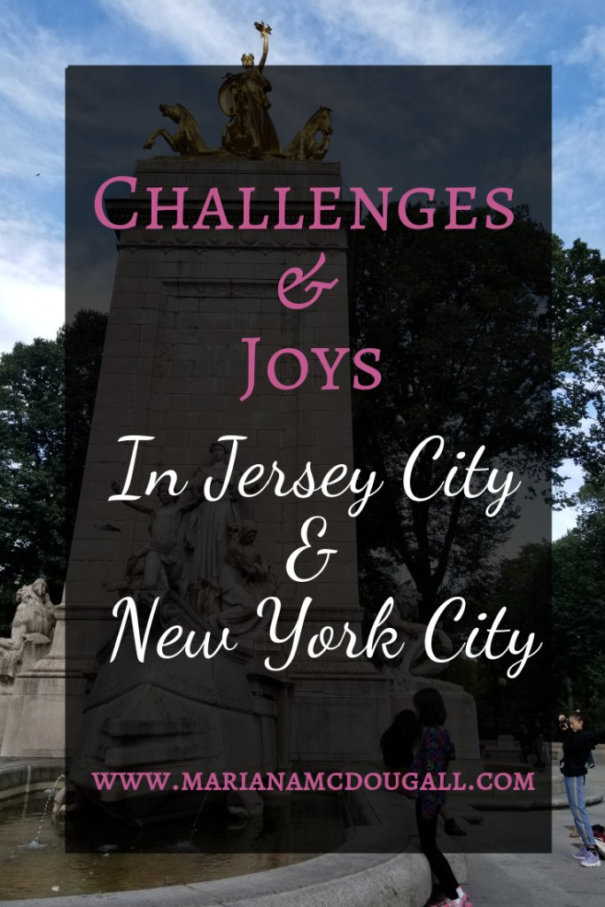 Challenges & Joys in Jersey City & New York City, www.marianamcdougall.com, white and pink lettering in front of a black square, with the USS Maine monument in the background.