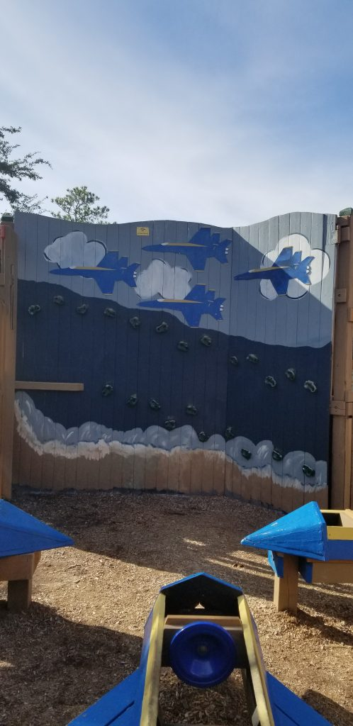 Climbing wall at Perdido Kid's Park. The wall is painted with airplanes.