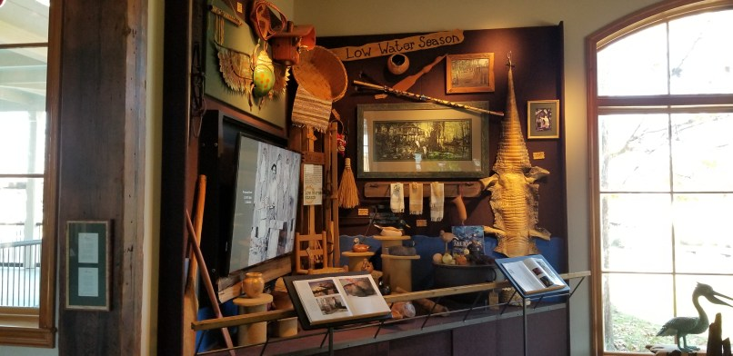 Low water season display at Atchafalaya Visitor Center, Louisiana. Alligator skin, baskets, and books.