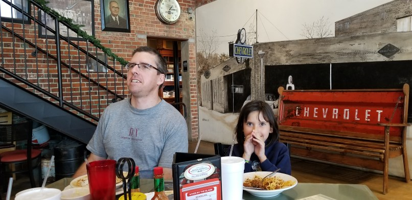 Father and daughter sharing a meal at Buck and Johnny's Restaurant in Breaux Bridge, Louisiana