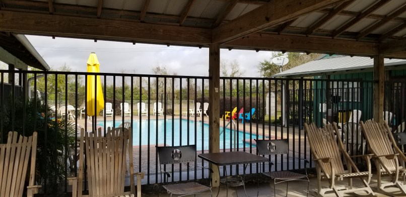 Swimming pool behind a gate at Gulf Coast RV Resort
