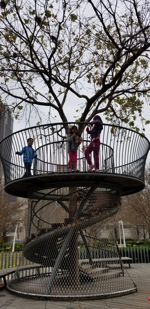 Three children stand atop the Story tower at Klyde Warren Park, Dallas