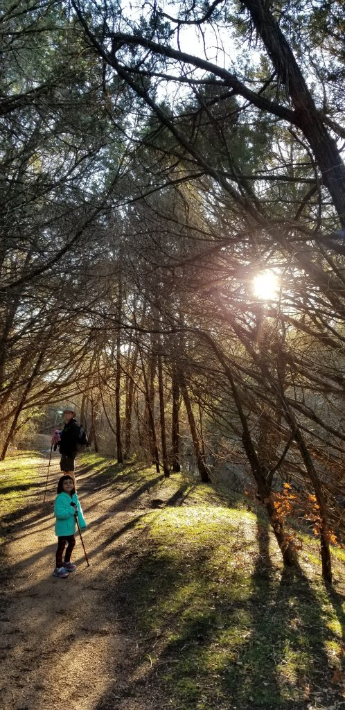 Father and 4-year-old daughter in Little Springs Trail in Meridian State Park