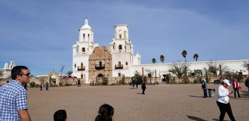 San Xavier del Bac Mission façade. A white church with two towers.