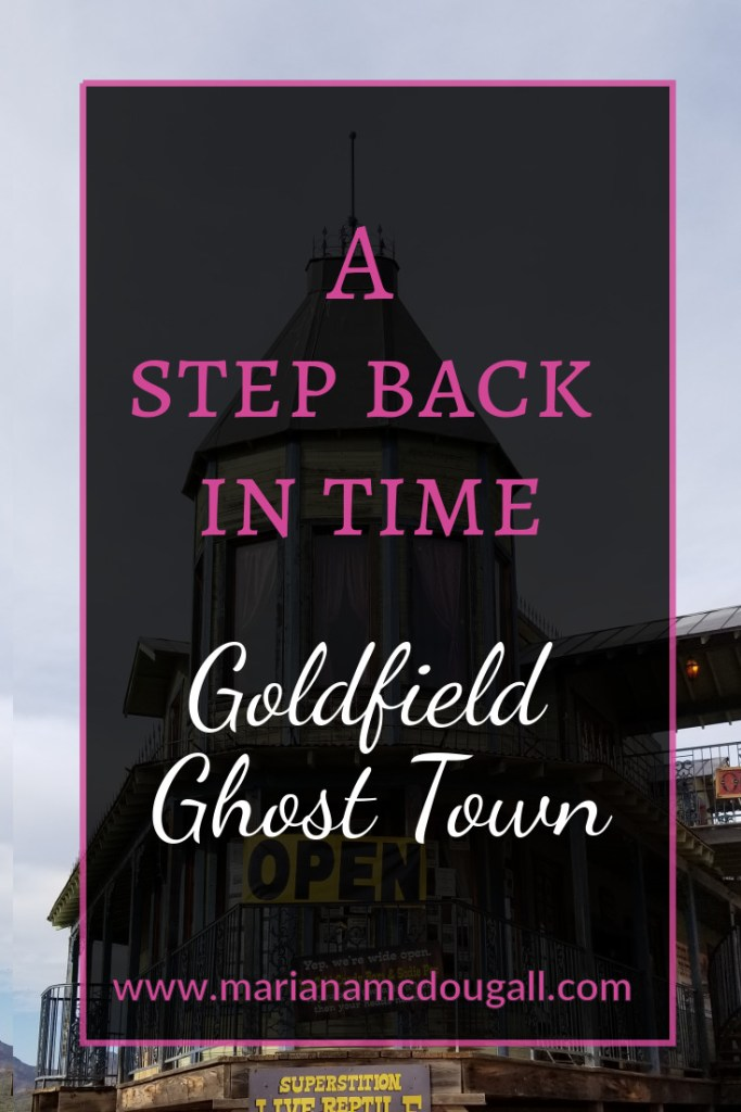 Pinterest Title Image. Pink and white letters read: A Step back in time, Godlfield Ghost Town, www.marianamcdougall.com. Background photo by Mariana Abeid-McDougall shows the bordello building in Goldfield Ghost Town.