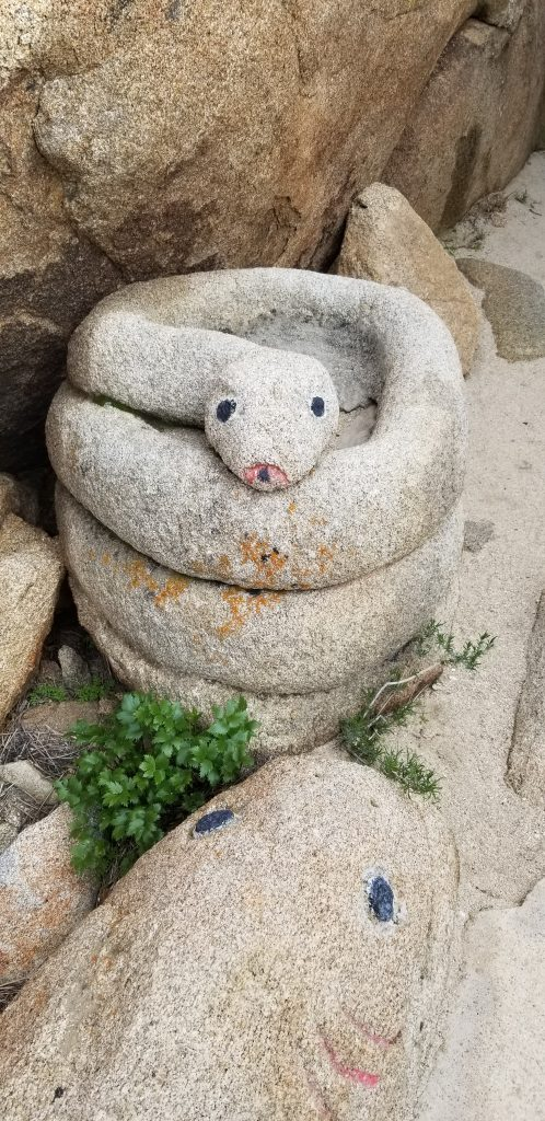 snake stone sculpture in Bolder Park, Jacumba, Arizona