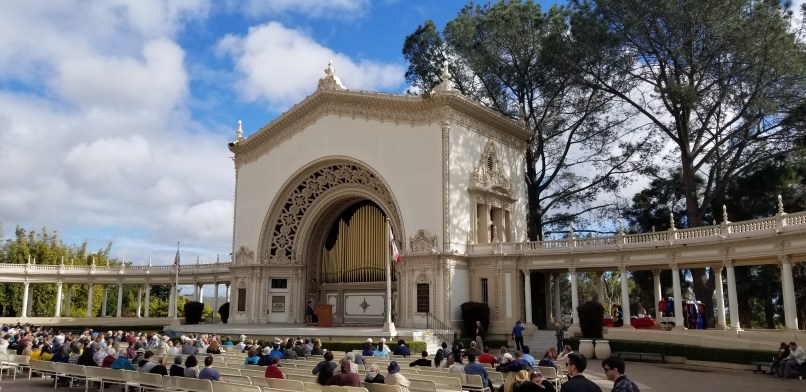 Man playing Spreckles organ in front of an audience in Balboa Park San Diego, California