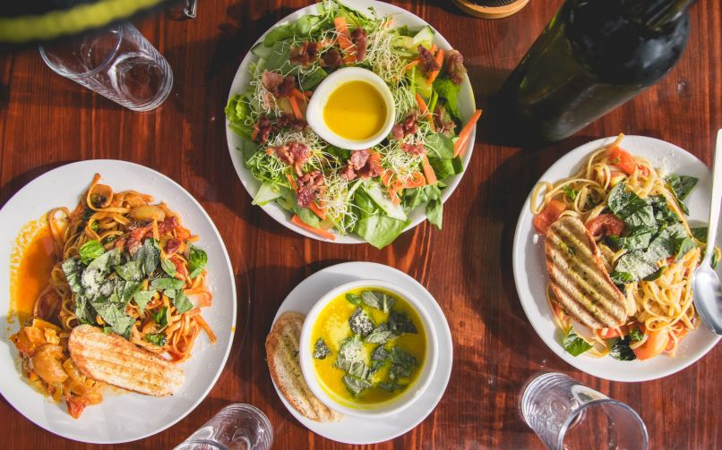Cooked food on a table, Photo by Vernon Raineil Cenzon on Unsplash