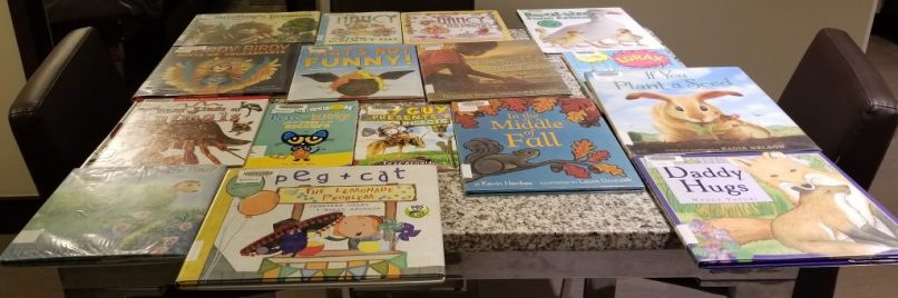 Several children's picture books on a table. Children's book reviews on www.marianamcdougall.com