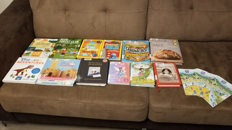 Several children's books on a sofa. Chidlren's books we read this week on www.marianamcdougall.com