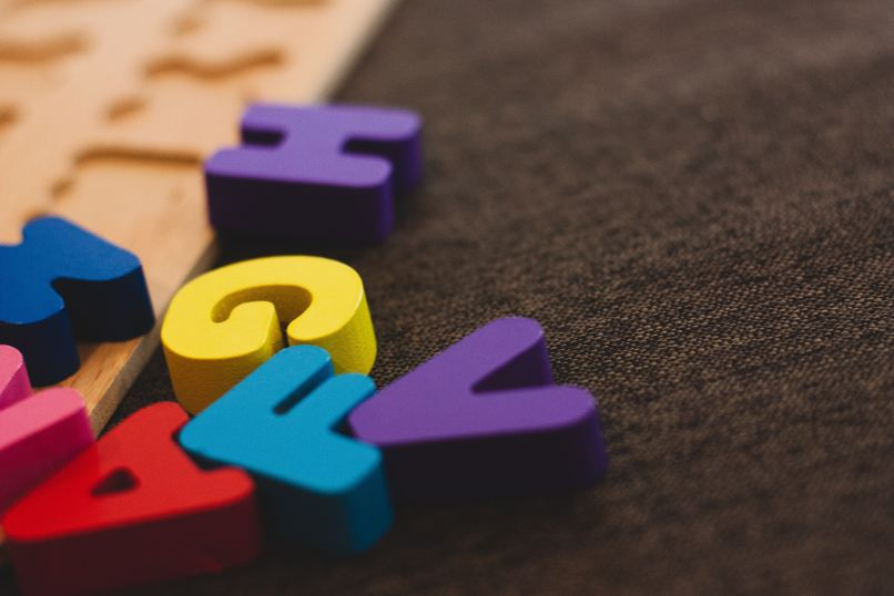 The Ultimate List of Free Homeschooling Resources on www.marianamcdougall.com. Photo description: colourful foam letters on a carpet. Photo by Ryan Wallace on Unsplash