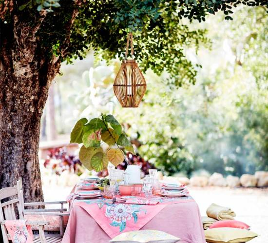 Summer table setting under a tree