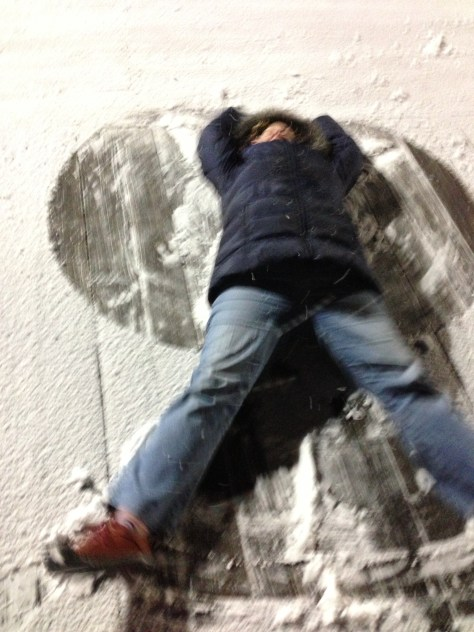M makes a snow angel on the Ocean City boardwalk