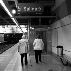 Two grandparents coming out from the station.