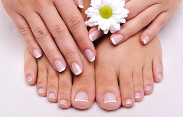 Skincare of a beauty female feet with camomile's flower