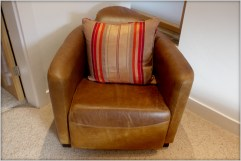 Designer Furniture : Italian Deco : Brown leather arm chair at Marie Charnley Interiors