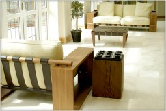 Designer Furniture : Yask Y Motion, Solid Wood Hocker in Walnut at Marie Charnley Interiors