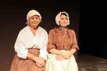 Photograph of Marie Cooper actor as Mrs Blaby with Mrs Peverill having a moments rest in Lark Rise at Sewell Barn Theatre in Norwich