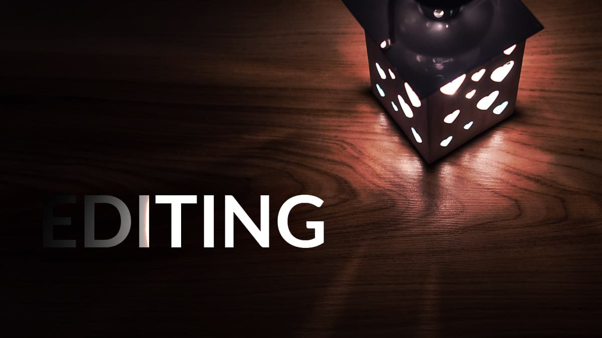 Lamp shining light onto the word editing