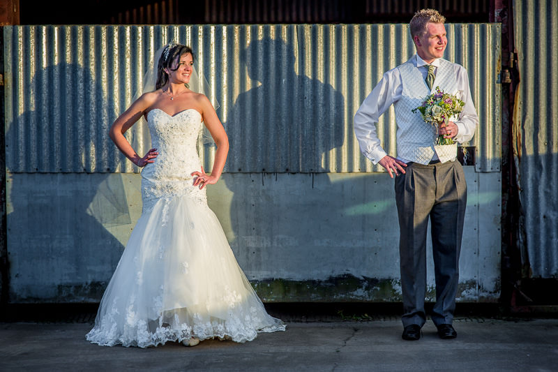 Contemporary wedding portrait with groom holding the flowers