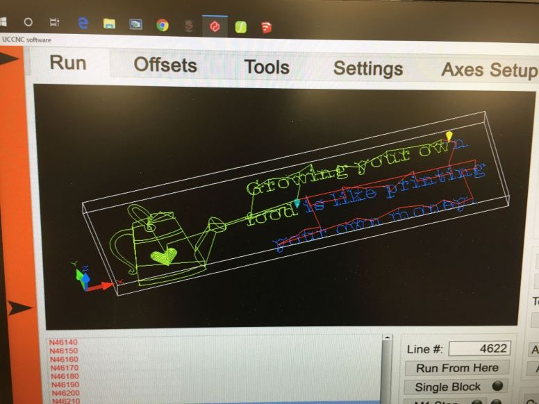 Monitoring the CNC toolpath progress.