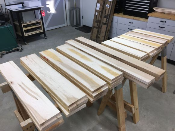 Rough parts cut for sizing and laminating. From left to right, four legs, two long rails, and five short rails.
