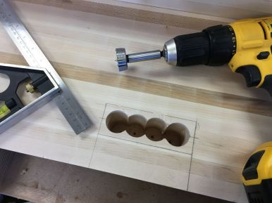 Combination square used to check depth of drilled holes