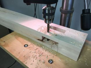 Drilling leg holes in legs on the drill press