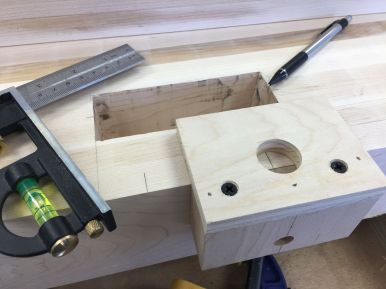Custom jig for hand drilling peg holes in bench top