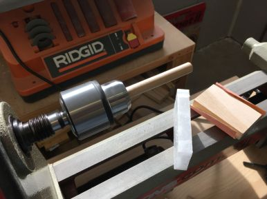 Chamfering and waxing pegs on the lathe