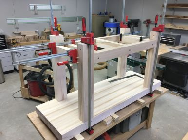 Leg and rail subassemblies glued and clamped, ready for pegs