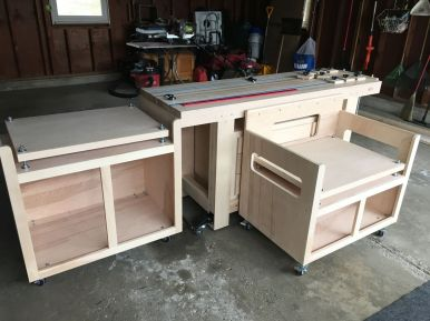 Chop saw and bench saw stands adjacent to the workbench