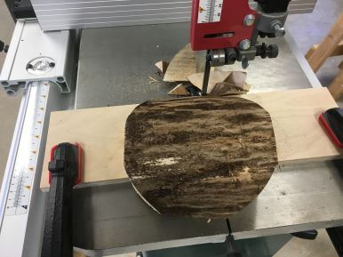 With the bandsaw table tilted, a rough outside bowl shape was produced, reducing the amount of material to be removed on the lathe