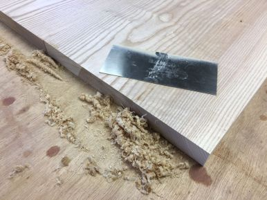 A spring steel card scraper was used to clean up and level the glue joints.