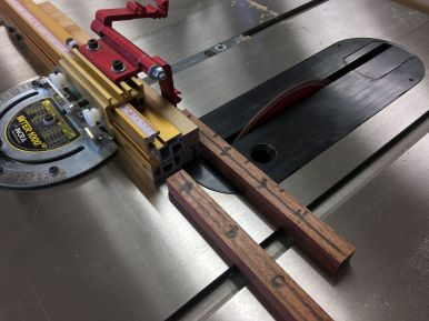 Cross cutting Brazilian Cherry blanks to length for a couple of pen and pencil sets.