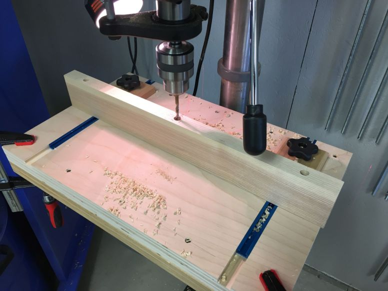 Drill press setup for drilling the breadboard ends in multiple steps
