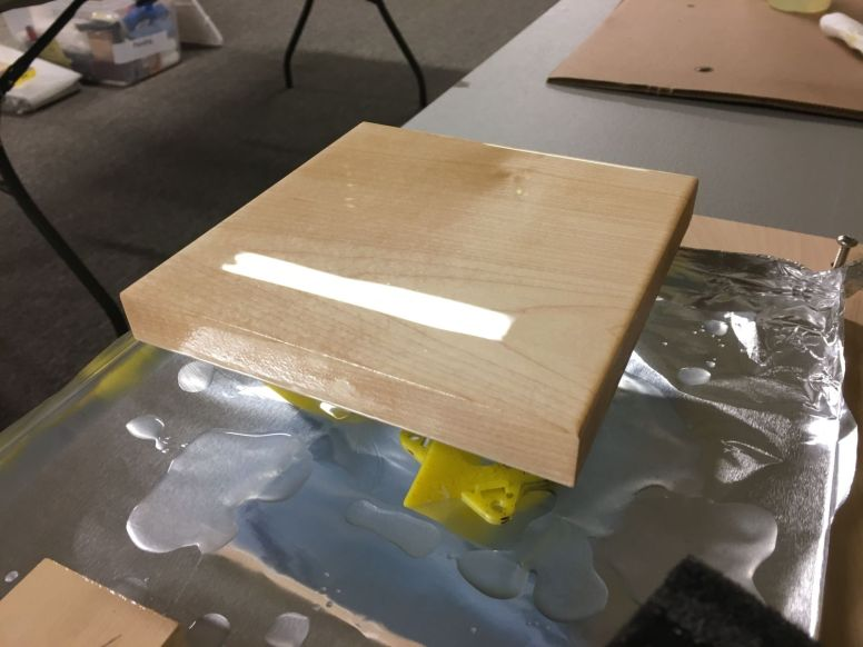 Using enough epoxy to allow it to flow across the sample surface and self-level seems to be the key to a successful coating