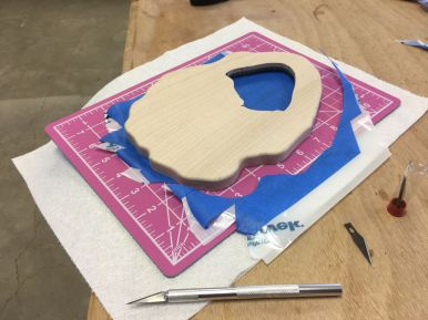 Trimming the mask with a No. 11 blade and cutting mat