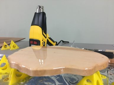 First coat of epoxy on the back of the back shows a glass like surface