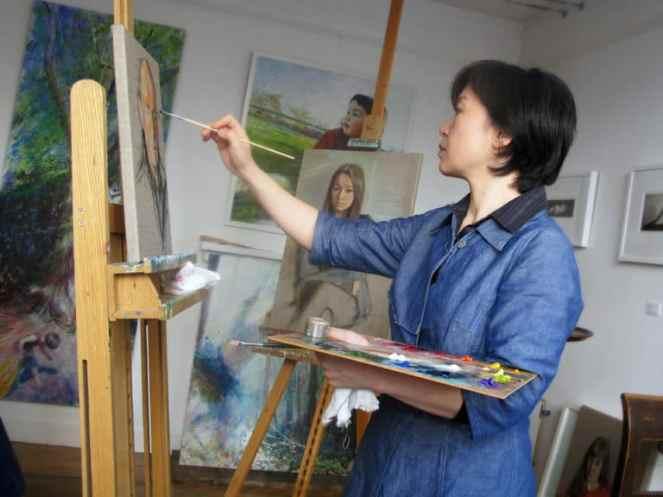 British portrait artist painter-printmaker Marina Kim in the studio. Photograph by Stuart Weston-Smith