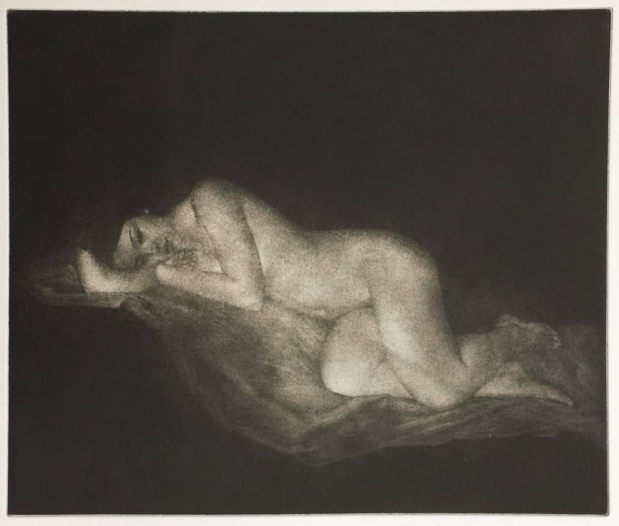 """""""Claire"""" - picture of a female nude model reclining, against a black background. Original print mezzotint by painter-printmaker Marina Kim"""