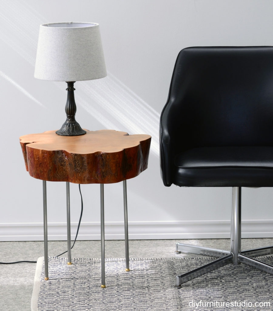 live edge tree slice side table with legs made of lamp pipe