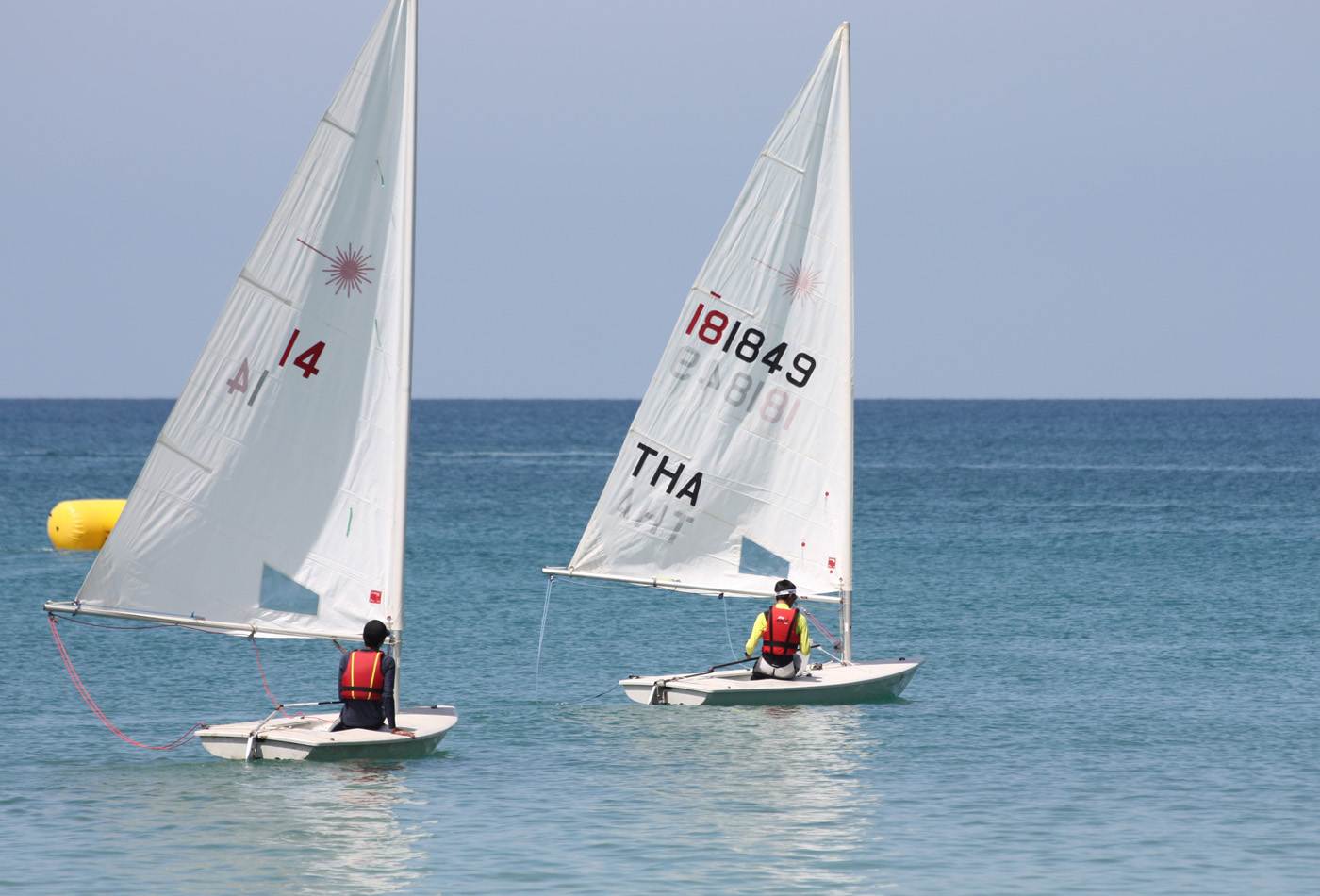 Light winds proved challenging for the Laser Class at Act II of the 2012 Phuket Dinghy Series held off Bang Tao Beach. Photo by MarineScene.asia.